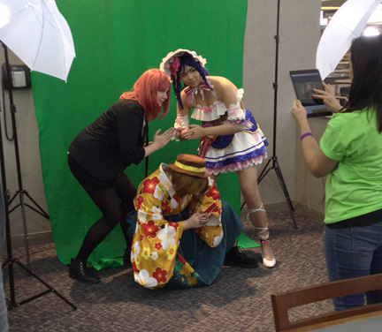 Cosplayers in front of a green screen